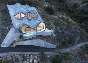 A futuristic Spanish home perched on a cliff offers ...