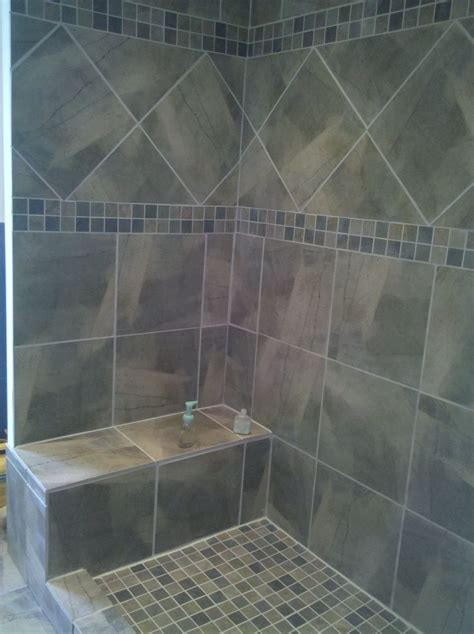 sophisticated gray diagonal tiled shower patern