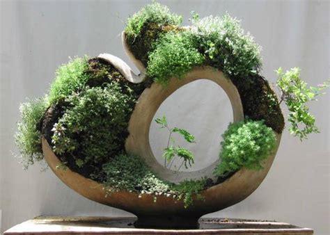 handmade concrete planters adding living sculptures