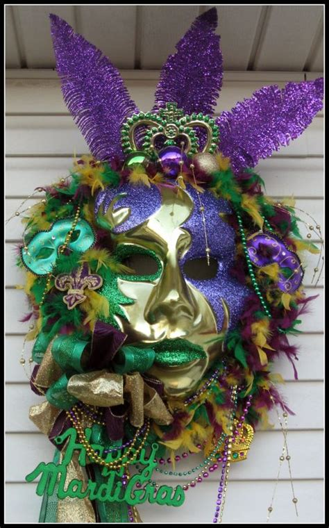 mardi gras mask with feathers ribbon and beads decoration