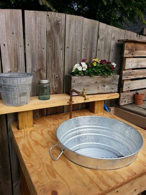 outdoor sink   scrap wood galvanized wash tub