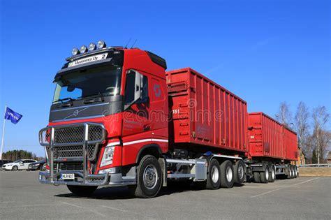 red volvo fh truck  full trailer  blue sky