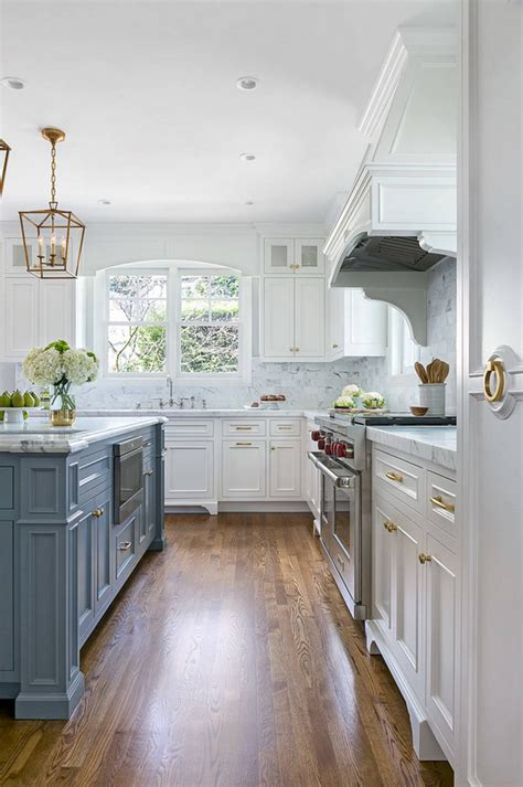 white kitchen  stacked cabinets  grey island home