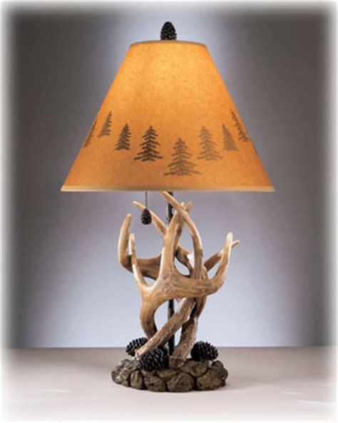 derek rustic antlers  pine cone based table lamp