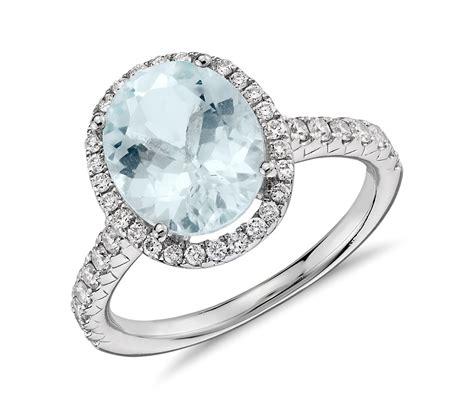anillo  halo de diamantes  aguamarina en oro blanco de