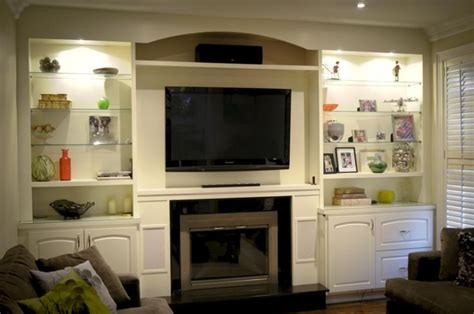 built in place custom wall units with fireplace icicle white built in wall unit and fireplace surround