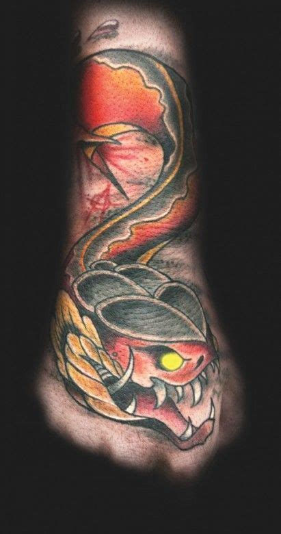 snake hand tattoo  travis brown inkedmagazine snake