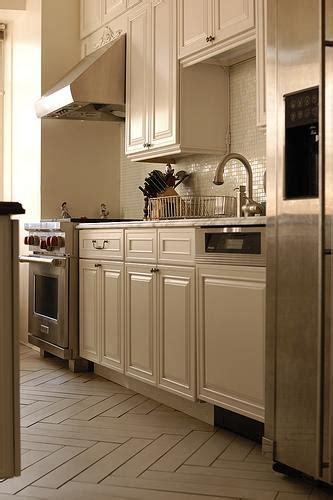 herringbone floor transitional kitchen