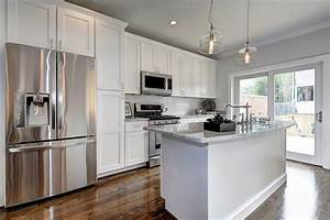 Haute indoor couture kitchens white and grey kitchen for Kitchen colors with white cabinets with haute couture wall art