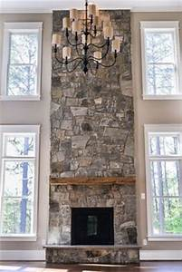 1000+ images about Two story stone fireplace ideas on