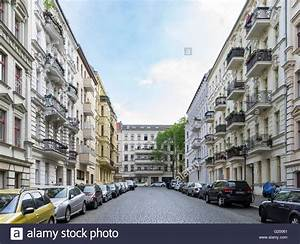 Typical street view of traditional apartment buildings and ...