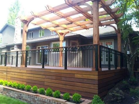 red balau deck  wrought iron railing  cedar pergola