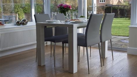 white high gloss extending dining table  chairs uk