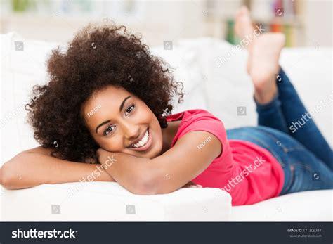 beautiful laidback african american woman relaxing stock