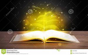 Open Book With Golden Glow Flying Paper Pages Stock Photo ...
