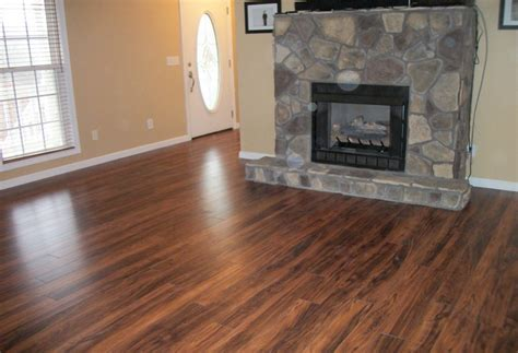 laminate wood flooring around fireplace laying laminate wood flooring around fireplace
