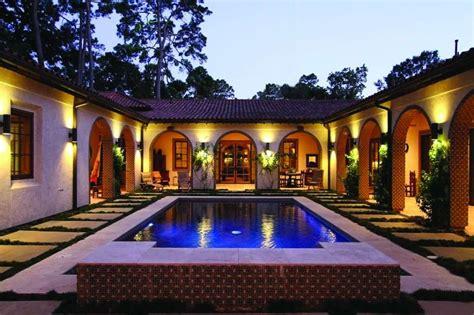 memorials bayou woods hacienda style home includes casita courtyard house plans spanish