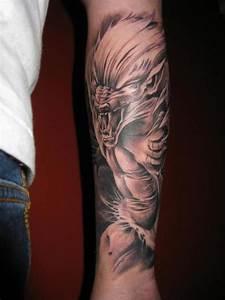 Werewolf tattoo on his arm - Tattooimages.biz