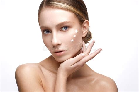 Young Girl With A Healthy Skin And Nude Makeup Beautiful Model On Cosmetic Procedures With A