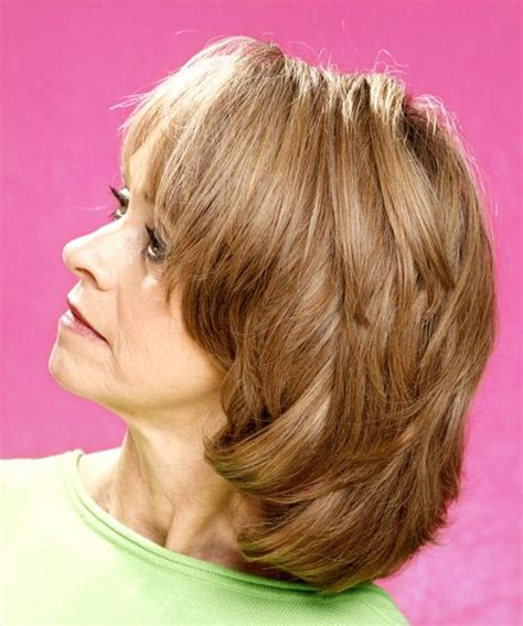 trendy short to medium hairstyles with bangs and layers