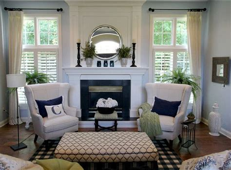 Living Room Design Around Fireplace by The Blue Wall Color With White Trim And Curtains And
