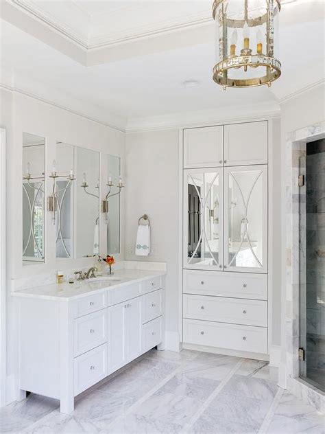 mirrored linen cabinet transitional bathroom
