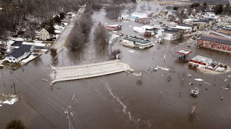 heavy rain atop frozen ground  flooding  midwest
