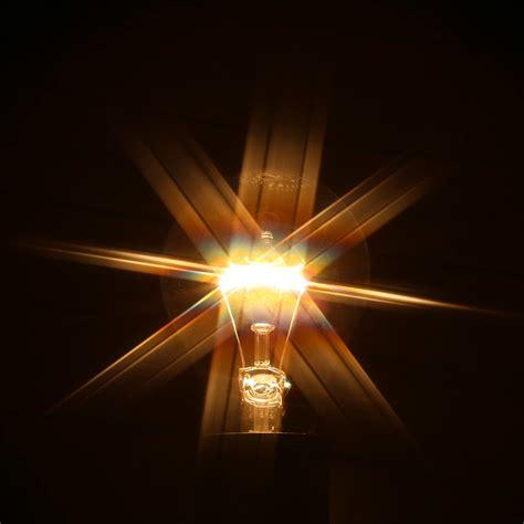 glowing light bulb  rays  light flickr photo sharing