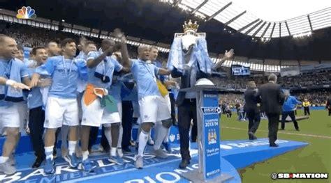 manchester city fans invade  pitch  celebrate