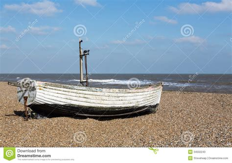 Old Boat On Beach Images by Old Fishing Boat On Pebble Beach Stock Image Image 34502243