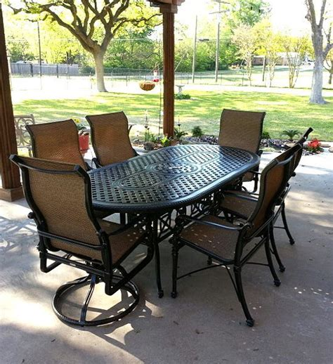 grand terrace dining table with high back sling dining