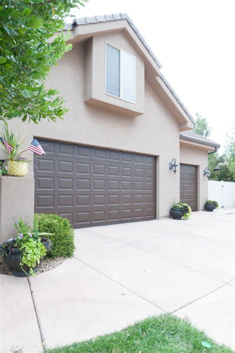 how to paint a garage door how to paint garage doors and add curb appeal to your home