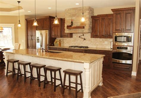 wood kitchen cabinets with white island the white island and the stained cabinets kitchen