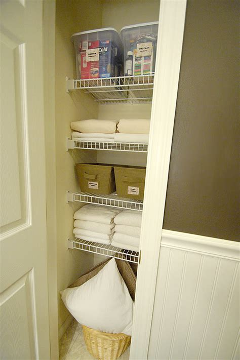 bathroom linen closet ideas how to fold fitted sheets plus a look in my