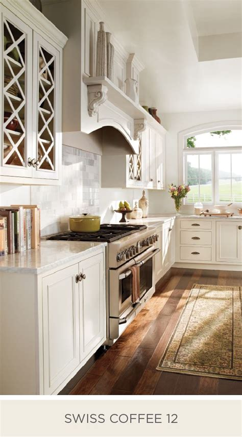 farmhouse chic kitchen glows  natural lighting    neutral shade  swiss