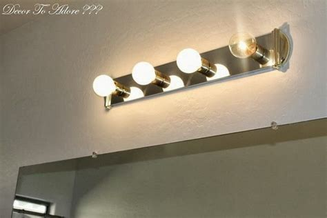 How To Remove A Bathroom Light Fixture by How To Remove Bathroom Lighting And Live To Tell