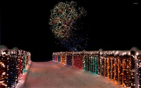 colorful christmas lights on the snowy bridge wallpaper