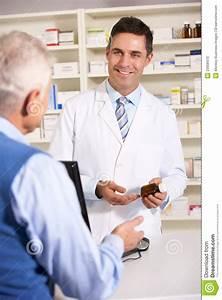 Elderly Man Talking With American Pharmacist Stock Photo ...