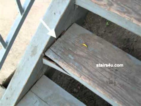 cracked  sagging wood stair steps exterior stair