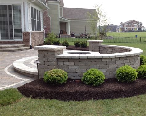patio seat wall design raised patio with seat wall and firepit installed by brick paving of indianapolis outdoors