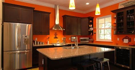 bright orange kitchen walls with stained cabinets