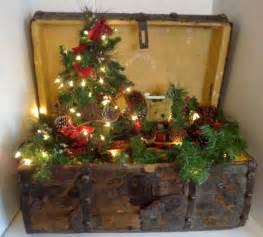 antique christmas trunk with christmas tree and lights