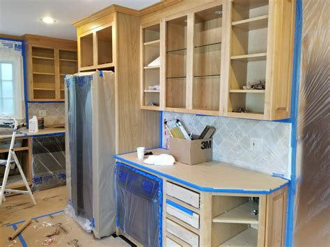 companies that spray paint kitchen cabinets kitchen cabinets spray finishes paint track painting