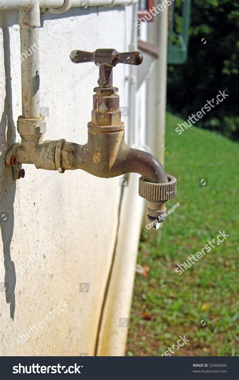 Outdoor Faucet Leaking Inside Wall by A Leaking Faucet Tap In A Garden Against A Wall Stock