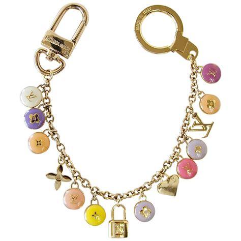 louis vuitton logo bag charm pastilles gold  pastels  stdibs