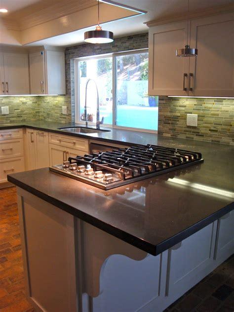 tasty kitchen peninsula  cooktop sherri cassara designs  clean slate kitchen penin