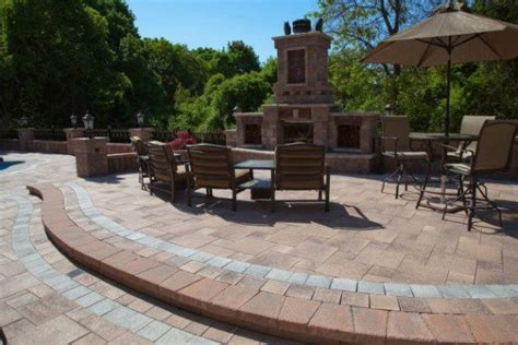 Umbriano Unilock - umbriano paver patio with border and fireplace by unilock