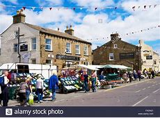 Tourists shopping at Hawes Market Hawes, Wensleydale