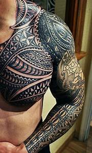 Black And Grey Celtic Tattoo On Man Chest And Sleeve