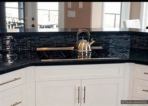 Backsplash goes black cabinets home design inside for Black granite with glass backsplash